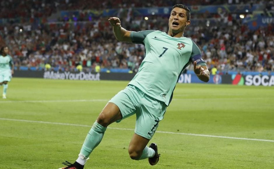 Cristiano Ronaldo peels away in celebration after heading Portugal in front and putting them one step closer to the Euro 2016 final. AP