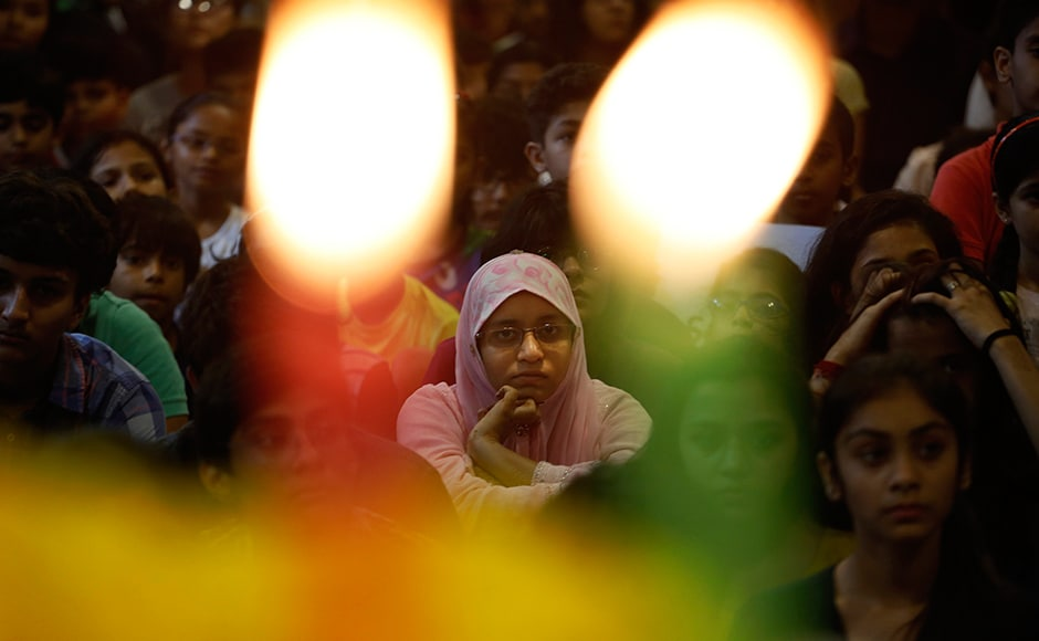 School children attend a prayer ceremony in memory of victims of a truck attack in France, at a school in Ahmadabad on Friday, 15 July, 2016. President Pranab Mukherjee wrote to French President Francois Hollande, conveying condolences on the loss of lives in a heinous act of terror in Nice. AP