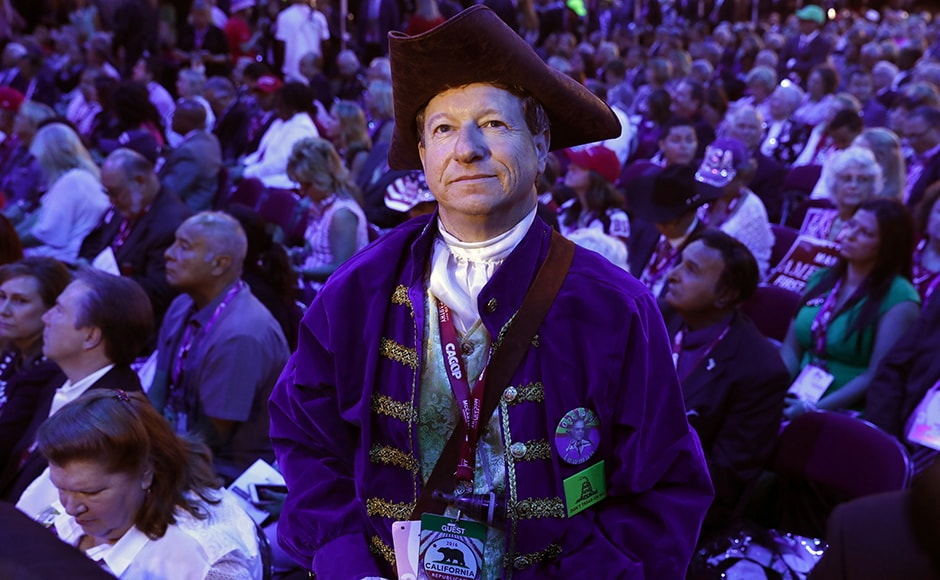 A California delegate in Revolutionary War garb stands amidst other delegates during the third session. Several political watchers are terming Trump's campaign a political revolution which succeeded while Bernie Sanders' revolution did not. Reuters