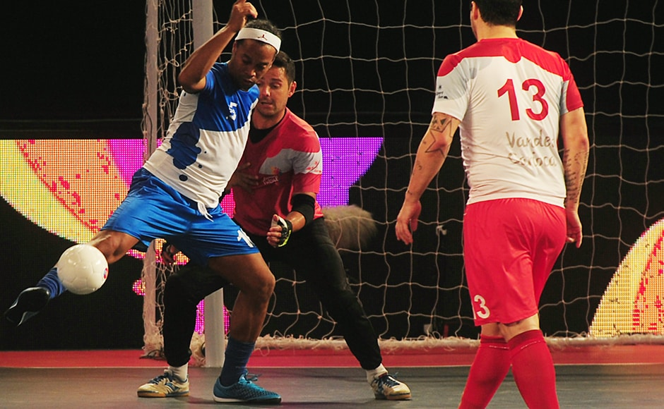 Ronaldhino (L) from the Goa 5's plays against the Kolkata 5's during their Premier Futsal Football League match in Chennai on July 15, 2016.