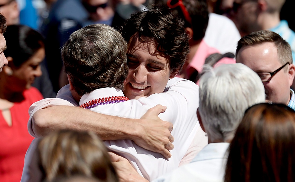 Trudeau also walked in the annual parade last year as head of the Liberal Party. Here, he hugs Mayor John Tory. Photo Courtesy: AP