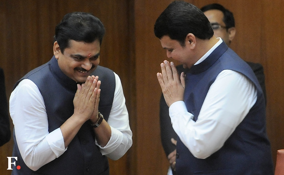 Ram Shinde, formerly minister of state for home (rural), was promoted to the rank of cabinet minister. He is congratulated by CM Fadnavis. A postgraduate in science, he is also a professor. Shinde is from Jamkhed in Ahmednagar. Sachin Gokhale/Firstpost