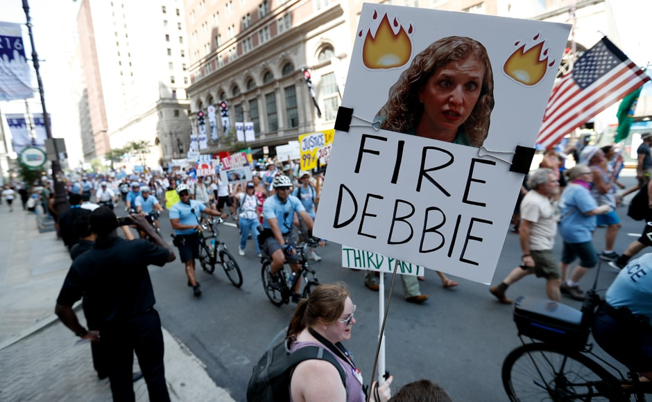 Sanders' supporters hold up a sign call calling for Debbie Wasserman Schultz, chairwoman of the Democratic National Committee to be fired. Schultz later stepped down. AP