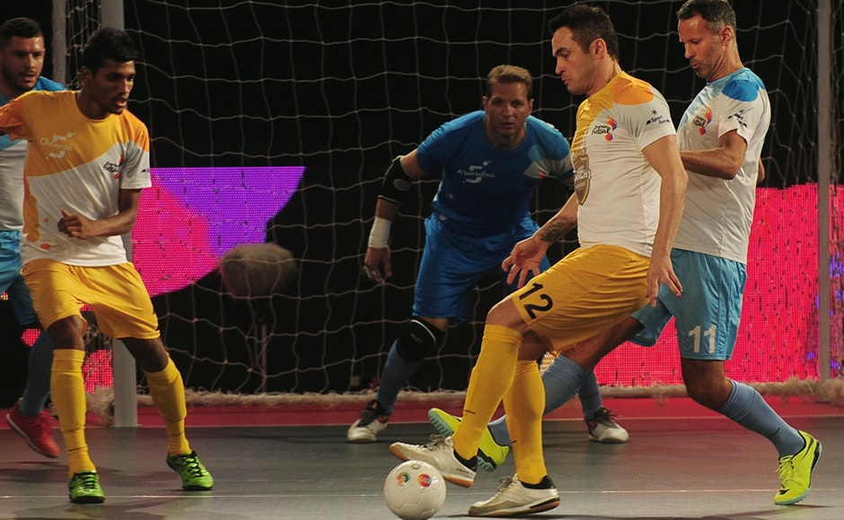 Alessandro Rosa Viera (2R), also known as Falcao, from the Chennai 5's plays against the Mumbai 5's during their Premier Futsal Football League match in Chennai on July 15, 2016. (ARUN SANKAR / AFP)