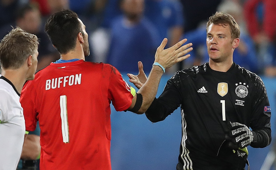 Italy's Gianluigi Buffon (left) and Germany's Manuel Neuer - two of the game's greatest goalkeepers - greet each other after the game. AP