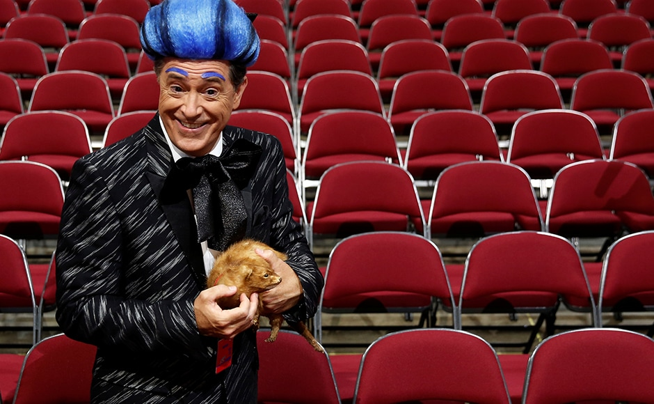 CBS television comedian Stephen Colbert films comedy bits with his crew on the floor of the RNC. He also snuck up to the stage dressed like the emcee from 'Hunger Games' and delivered a scathing attack on Trump before he was made to leave. Reuters