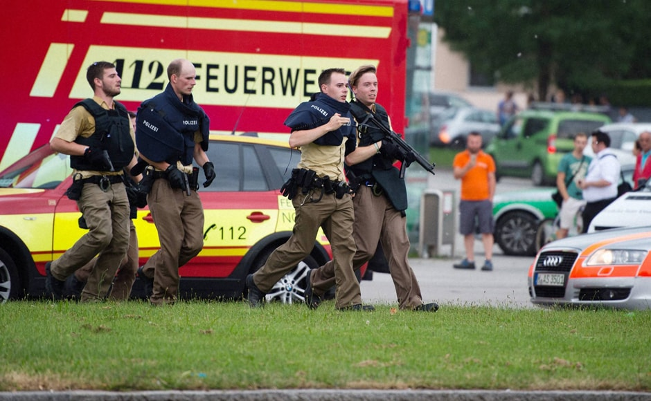 Police in Munich, Germany respond to a shooting at a shopping center in the city on Friday. AP