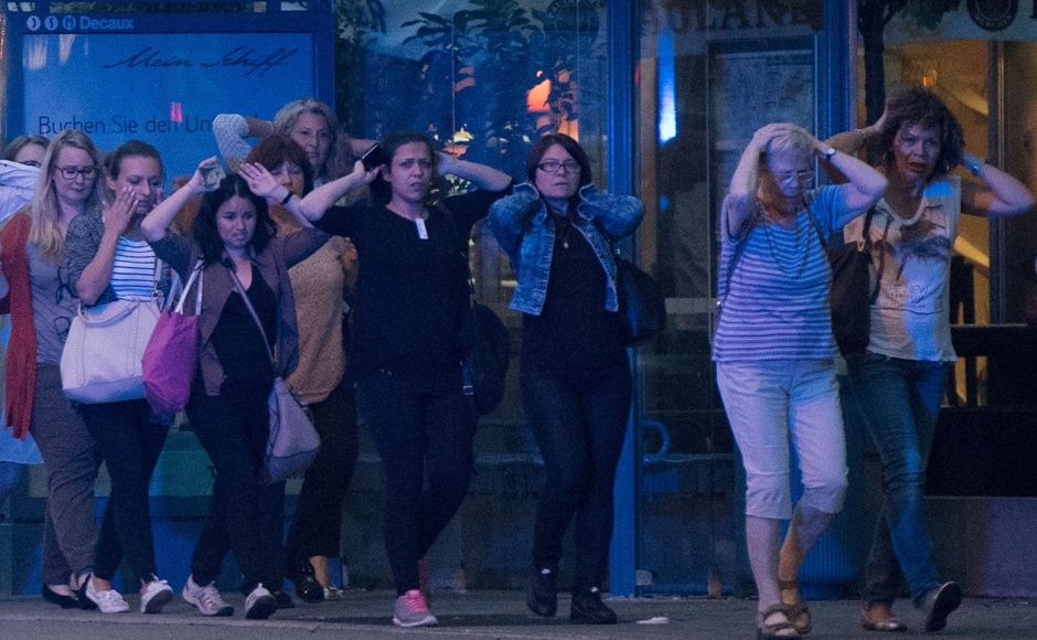 People leave the Olympia mall in Munich, southern Germany. AP/Sebastian Widmann
