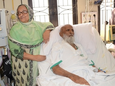 In this picture taken on June 25, 2016 Bilqees Edhi, stands next to her husband and Pakistan's renowned social worker Abdul Sattar Edhi at a hospital in Karachi, Pakistan. Pakistan's legendary philanthropist Abdul Sattar Edhi, who devoted his life to the poor and the destitute, died on Friday at a hospital in Karachi following a prolonged illness. He was 88. AP