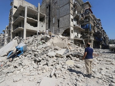 Men look for survivors amid rubble of damaged buildings after an airstrike on Aleppo's rebel held al-Maadi district. Reuters