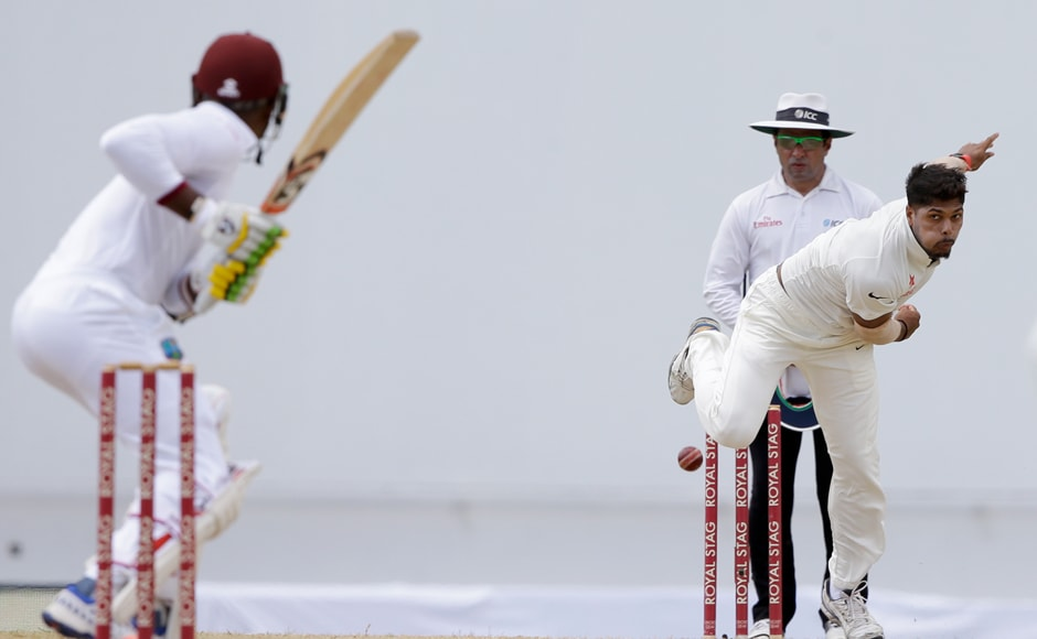 India's Umesh Yadav bowling to Windies batsman Marlon Samuels during day four. He ended up with figures of 5/75 in the first test match. AP