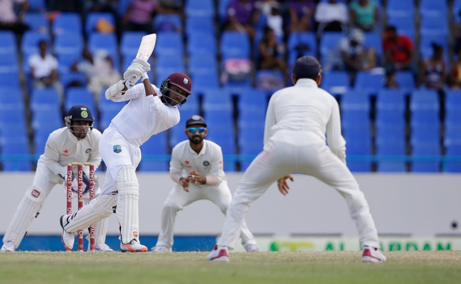 Devendra Bishoo tries to play a delivery bowled by Indian spinner Amit Mishra with wicketkeeper Wriddhiman Saha and Ajinkya Rahane looking on behind the stumps. AP