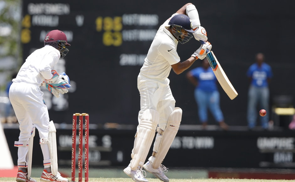 Ravichandran Ashwin plays a shot under the watchful eyes of West Indies wicketkeeper Shane Dowrich. Ashwin now has three centuries to his name, against Windies.