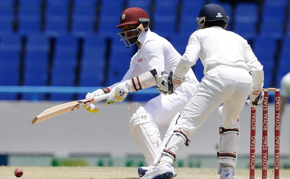 Marlon Samules parries a Ravichandran Ashwin delivery while Wriddhiman Saha watches on. Ashwin ended up with 7 wickets in the second innings. AP