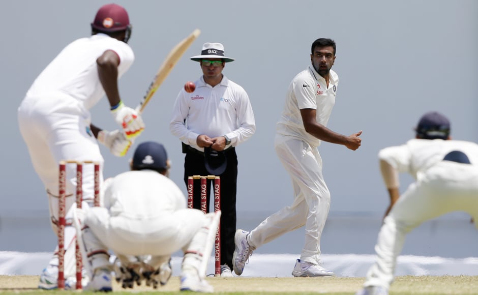 Ashwin in action against Windies batsman. The all-rounder scored a century and bagged figures of 7/126 in the first test match of the India in West Indies series. AP