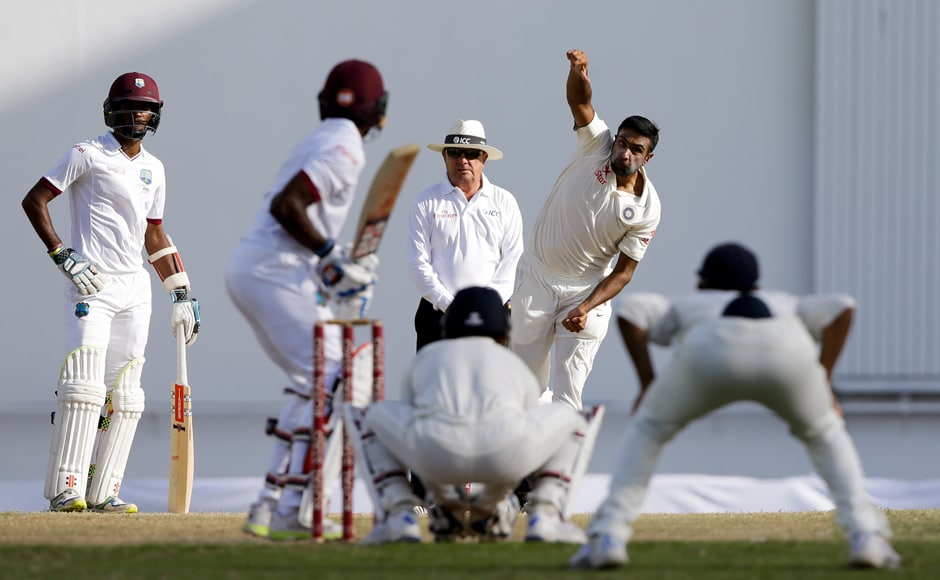 India's Ravichandran Ashwin bowls against West Indies. India restricted Windies to 31/1 as Day two came to a close. AP