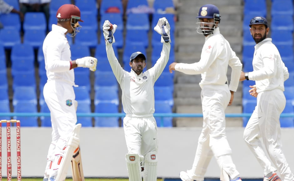 India's wicketkeeper Wriddhiman Saha appeals for the wicket of West Indies' Marlon Samuels, during Day four of their first Test cricket match at the Sir Vivian Richards Stadium. AP