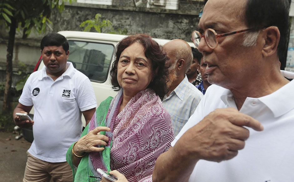 Razaul Karim, right, and Hosne Ara Karim, center, whose son and daughter-in-law were rescued from the restaurant attacked by heavily armed militants, wait for them in Dhaka on Saturday. AP