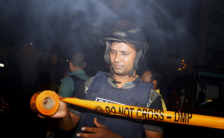 Bangladeshi security personnels cordon off the area after a group of as many as nine gunmen attacked a restaurant popular with foreigners in a diplomatic zone of Dhaka, Bangladesh on Saturday. Gunshots and sounds of explosion started to rock the area at 7:40 AM (local time) as security forces launched an offensive to end the 11-hour-long hostage crisis at a cafe in Dhaka's diplomatic zone Gulshan. AP