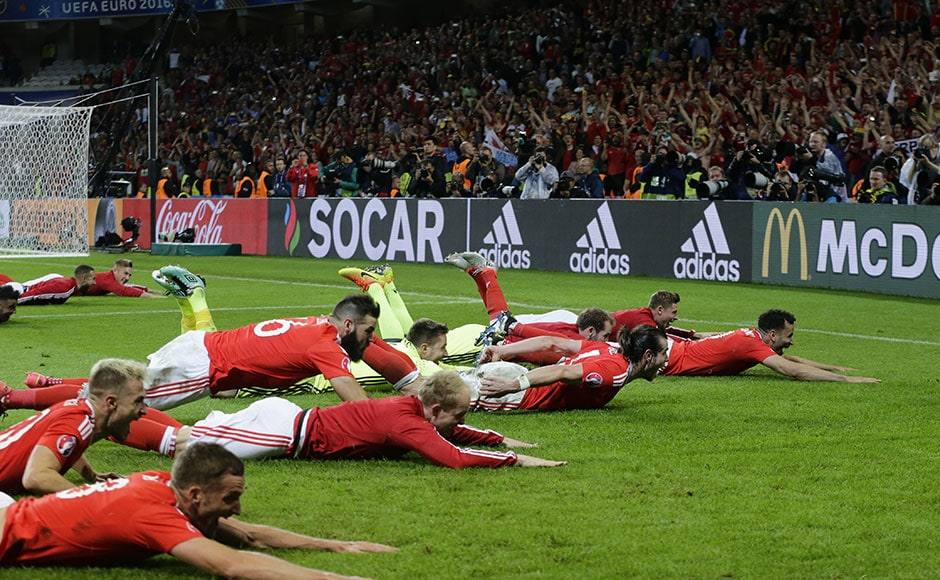 Welsh players celebrate their 3-1 win over Belgium. The relatively small team has exceeded every expectation that they and their supporters had when they made it to the Euro finals and will be remembered for generations to come as being the greatest. AP
