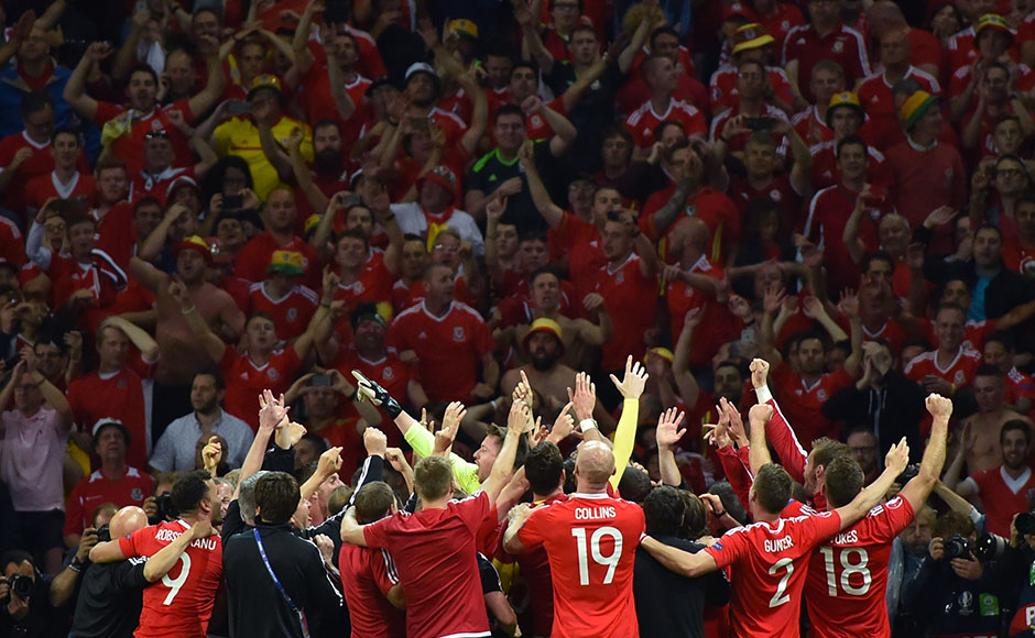 Wales' players celebrate their historic win in the Euro 2016 quarterfinals over Belgium as they qualify for the semis of a major tournament for the first time. AFP