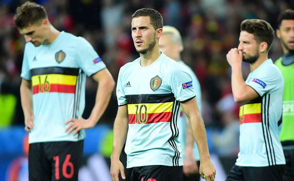 A dejected Eden Hazard reacts after Belgium's Euro 2016 quarter-final loss to Wales. The striker had earlier missed a shot on target. AFP