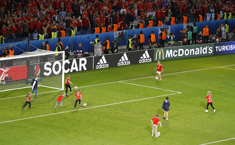 Child's play? Children of Wales' players play on the pitch after Wales' Euro 2016 quarterfinal win over Belgium. AP