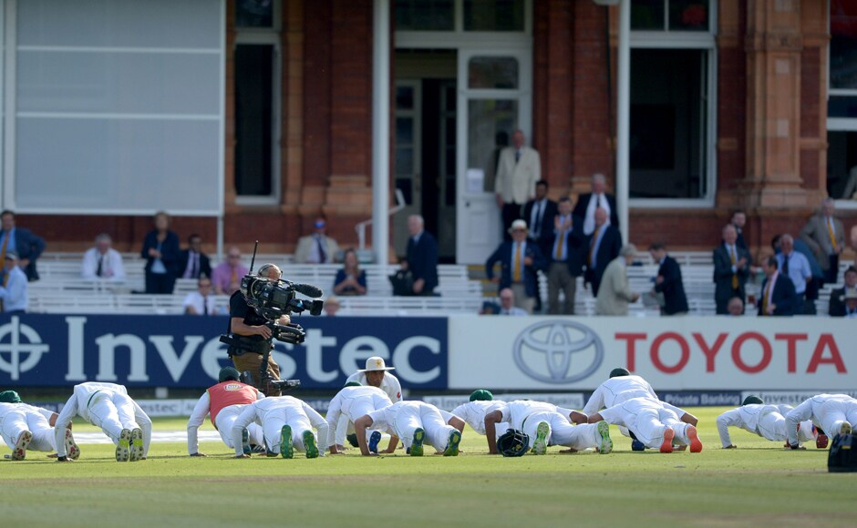 The Pakistan team celebrate by doing push-ups on the pitch, a tribute to the military camp they attended. Captain Misbah-ul-Haq had celebrated in similar fashion on the opening day on Thursday after reaching a hundred that helped set up his team's 75-run win. AP