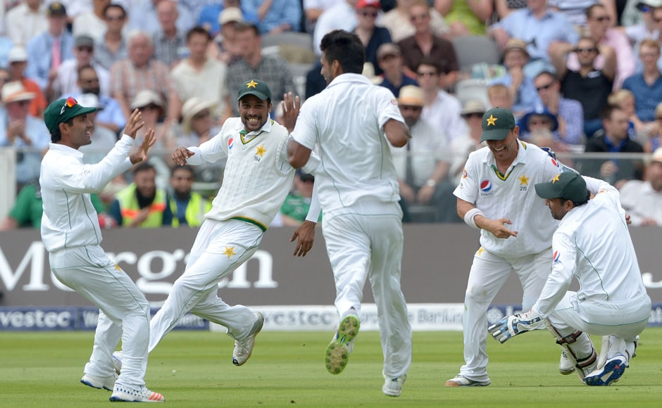 Yasir Shah celebrates taking the catch of Joe Root. AP