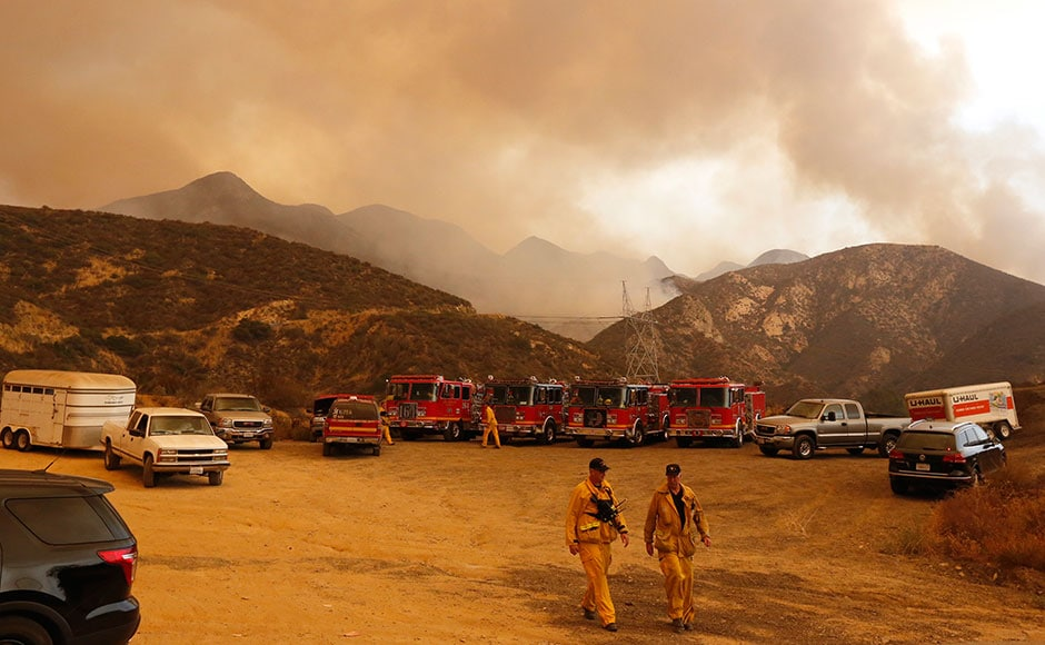 Fire trucks and horse trailers stage outside Wildlife Waystation in Santa Clarita. The wildfire burning in the mountainous Angeles National Forest north of Los Angeles has grown to more than 17 square miles. The Wildlife Waystation has about 400 animals on 160 acres within the national forest. AP
