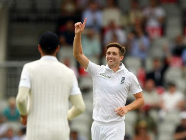 Chris Woakes (right) recorded 4/67 to help skittle Pakistan out for 198. Getty Images