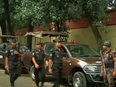 Police gather after gunmen attacked the Holey Artisan restaurant and took hostages early on Saturday in Dhaka. Reuters