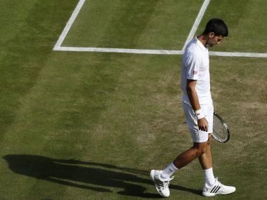 Novak Djokovic reacts after losing his match to Sam Querrey. Reuters