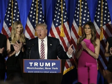 Republican presidential candidate Donald Trump speaks with daughter Ivanka (left) and wife Melania (right). Reuters