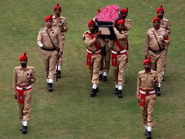 Pakistani soldiers carry the coffin containing the body of Abdul Sattar Edhi for a funeral in Karachi. AP