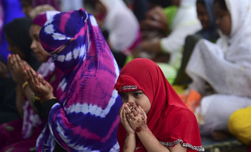 People gathered to pray on the eve of Eid in Dhaka. AFP