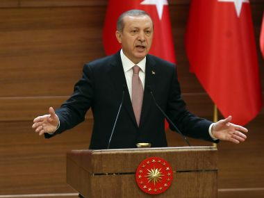 """Turkish President Recep Tayyip Erdogan delivers a speech during a mukhtars meeting at the presidential palace on November 26, 2015 in Ankara. President Recep Tayyip Erdogan on November 26 said Turkey does not buy any oil from Islamic State, insisting that his country's fight against the jihadist group is """"undisputed"""". AFP"""
