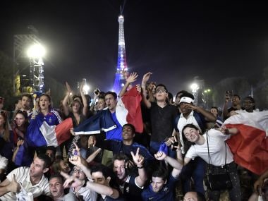 France's supporters celebrate in front of the Eiffel Tower. AFP