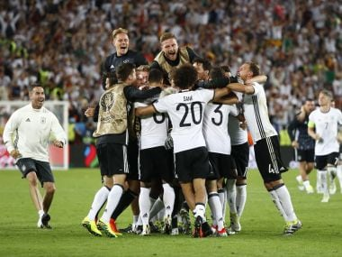 Germany players celebrate winning the penalty shootout. Reuters