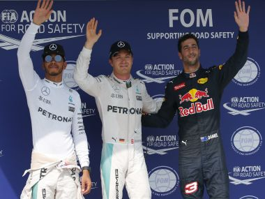 Mercedes' Lewis Hamilton and Nico Rosberg with Red Bull Racing's Daniel Ricciardo after qualification. Reuters
