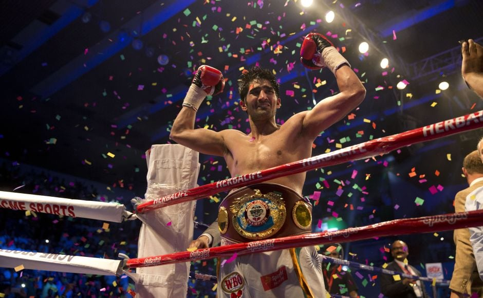 Vijender Singh celebrates after wining WBO Asia Pacific Super Middleweight title against Australia's Kerry Hope in New Delhi. AP