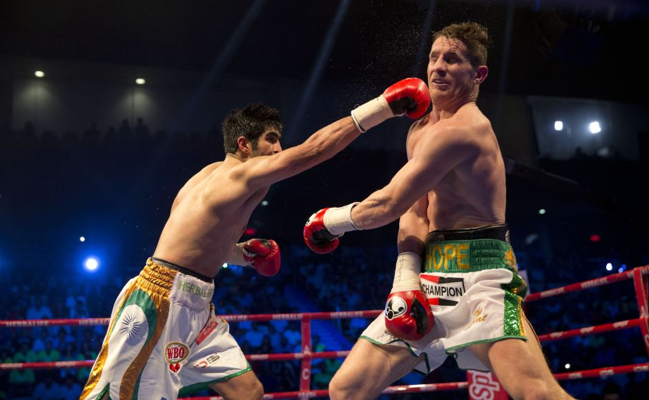 Vijender Singh throws a punch at Australia's Kerry Hope during their fight for the WBO Asia Pacific Super Middleweight. AP