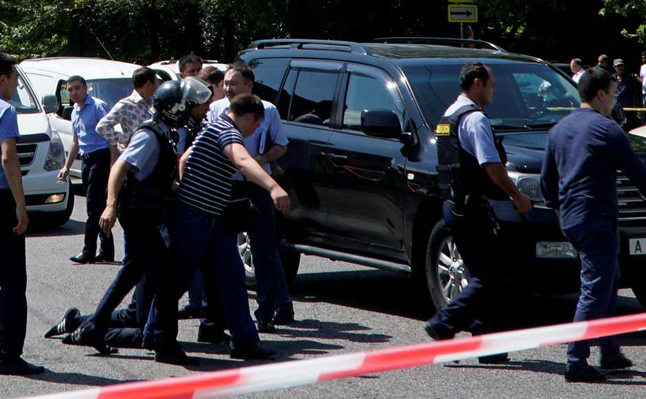 The attack comes a month after 20 people were killed in the Kazakh city of Aktobe when groups of gunmen attacked a military base and a gun shop. Authorities in this Central Asian nation then described the violence as a terrorist attack and blamed it on radical Islamists. Reuters