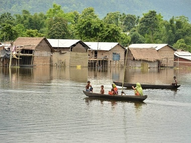 Kaziranga: Villagers commute by rowing boats in a flooded village near Kaziranga National Park on Tuesday. PTI Photo (PTI7_5_2016_000223B) *** Local Caption ***