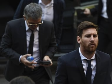 File picture of Lionel Messi (R). AFP
