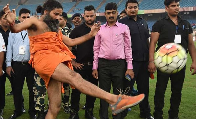 Baba Ramdev kickstarts the match. PTI