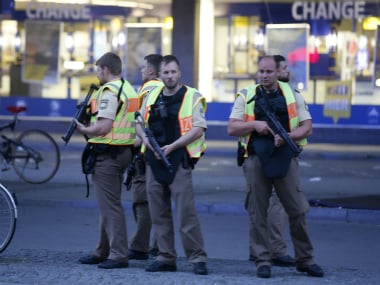 Police officers stand guard outside the main train station following a shooting rampage at the Olympia shopping mall in Munich on Friday. Reuters