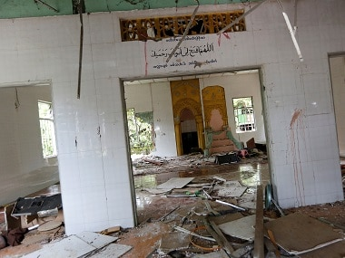 The interior of a destroyed mosque after a group of men attacked it in the first serious outburst of inter-religious violence in months in the village of Thayethamin outside Yangon on 24 June. Reuters