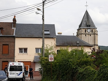 French CRS police secure a street near the church where a priest was killed during a hostage situation in Saint-Etienne-du-Rouvray. Reuters