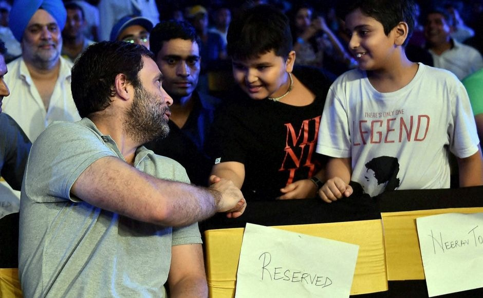 Congress Vice Pesident Rahul Gandhi greets his young fans at the WBO Asia Pacific Middleweight Championship at Thyagaraj Sports Complex in New Delhi on Saturday. PTI